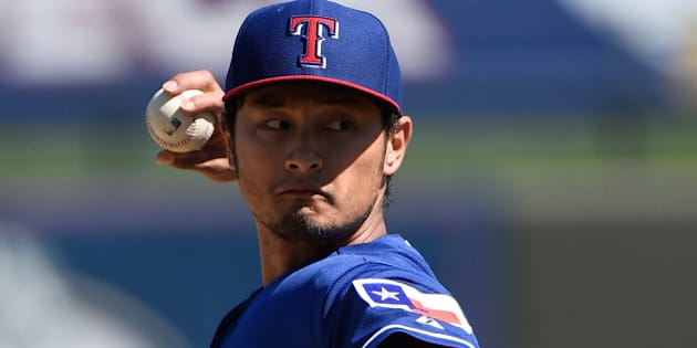 SURPRISE, AZ - MARCH 05:  Yu Darvish #11 of the Texas Rangers pitches in the first inning against the Kansas City Royals at Surprise Stadium on March 5, 2015 in Surprise, Arizona.  (Photo by Lisa Blumenfeld/Getty Images)