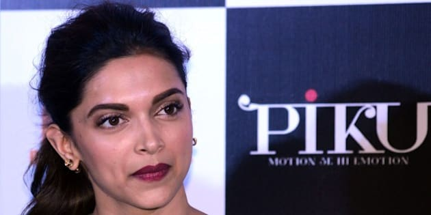 Indian Bollywood actress Deepika Padukone looks on during a promotional event for the forthcoming Hindi film 'Piku' directed by Shoojit Sircar in Mumbai on late March 25, 2015. AFP PHOTO / STR        (Photo credit should read STRDEL/AFP/Getty Images)