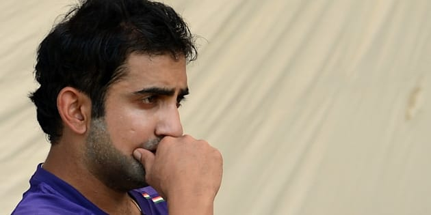 Indian cricketer Gautam Gambhir watches teammates during a training session at The Sardar Patel Stadium at Motera in Ahmedabad on November 14, 2012. India plays their first test cricket match against England from November 15 in Ahmedabad. AFP PHOTO/ PUNIT PARANJPE        (Photo credit should read PUNIT PARANJPE/AFP/Getty Images)