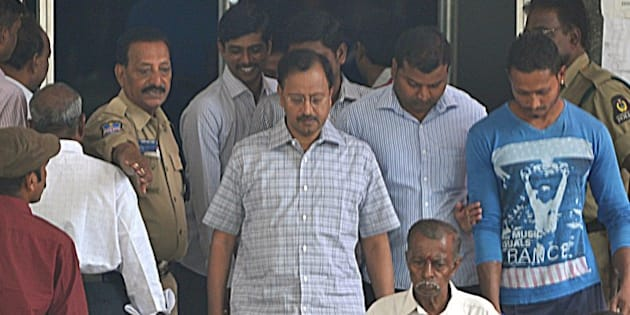 B. Ramalinga Raju (C), the former chairman of outsourcing giant Satyam, walks out of the Metropolitan Criminal Courts in Hyderabad on March 9, 2015. An Indian court postponed a verdict in the multi-billion-dollar Satyam fraud case until April 9.  AFP PHOTO / Noah SEELAM        (Photo credit should read NOAH SEELAM/AFP/Getty Images)