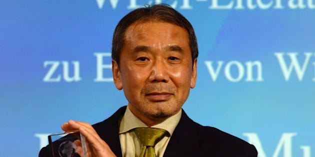 Japanese writer Haruki Murakami poses with his trophy prior to an award ceremony for the Germany's Welt Literature Prize bestowed by the German daily Die Welt, in Berlin on November 7, 2014.  AFP PHOTO / JOHN MACDOUGALL        (Photo credit should read JOHN MACDOUGALL/AFP/Getty Images)