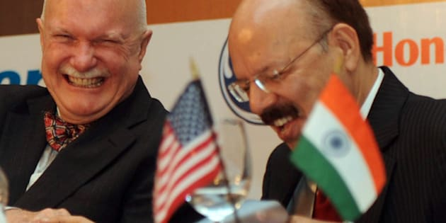 Director General of Indian Civil Aviation, Nasim Zaidi (R) talks with the US Ambassador to India, Peter Burleigh, during US-India Aviation Summit in New Delhi on November 17, 2011. India and US  signed two Aviation Safety Agreements between the US Federal Aviation Administration and India's Directorate General of Civil Aviation. AFP PHOTO/RAVEENDRAN (Photo credit should read RAVEENDRAN/AFP/Getty Images)