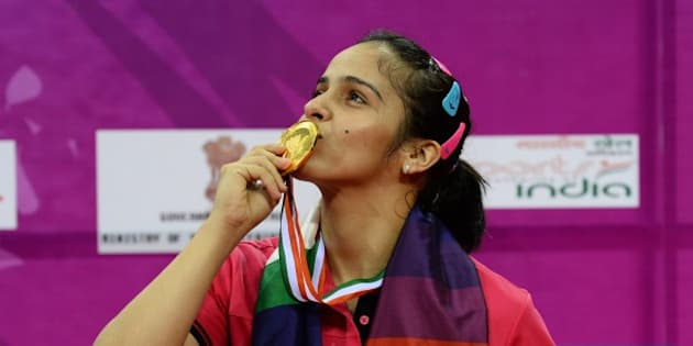 Saina Nehwal of India kisses her gold medal after winning her women's singles final match against Ratchanok Intanon of Thailand at the Yonex -Sunrise India Open 2015 at the Siri Fort Sports complex in New Delhi on March 29, 2015. AFP PHOTO / SAJJAD HUSSAIN        (Photo credit should read SAJJAD HUSSAIN/AFP/Getty Images)