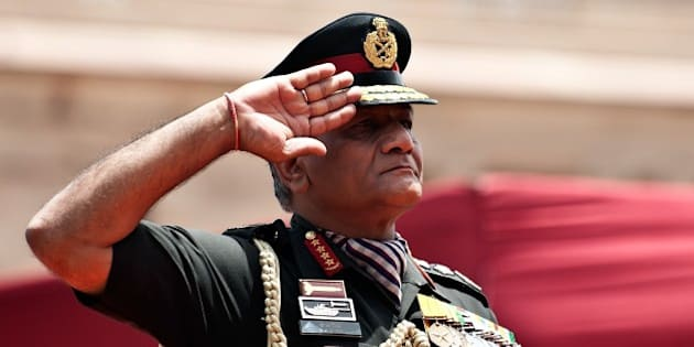 Outgoing Indian Army chief General V.K. Singh salutes a farewell guard of honour in New Delhi on May 31, 2012. The head of the Indian army retired May 31 after a stormy tenure in office that included a series of public spats with the government, amid speculation he may enter political life. General Vijay Kumar Singh took the government to the Supreme Court in January in an unprecedented dispute over his retirement due to confusion over his date of birth. Singh will be replaced by Lieutenant General Bikram Singh as Chief of Army Staff.   AFP PHOTO/ MANAN VATSYAYANA        (Photo credit should read MANAN VATSYAYANA/AFP/GettyImages)