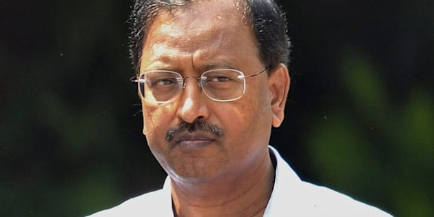 Indian former chairman of outsourcing giant Satyam, B. Ramalinga Raju, arrives to attend the final judgement of a fraud case against him and nine others at the Metropolitan Criminal Courts in Hyderabad on April 9, 2015. An Indian court on April 9, 2015, sentenced the former chief of outsourcing giant Satyam to seven years in jail over a $2.25 billion accounting fraud scandal dubbed 'India's Enron'. Byrraju Ramalinga Raju, his brother and eight others were found guilty of manipulating Satyam's books in a 2009 case that shook the industry and raised questions about the country's regulators.  AFP PHOTO/ Noah SEELAM        (Photo credit should read NOAH SEELAM/AFP/Getty Images)