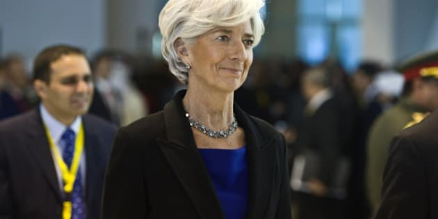 The Managing Director of the International Monetary Fund (IMF) Christine Lagarde (C) arrives for the Egypt Economic Development conference on March 13, 2015, in the Red Sea resort of Sharm el-Sheikh. AFP PHOTO / KHALED DESOUKI        (Photo credit should read KHALED DESOUKI/AFP/Getty Images)