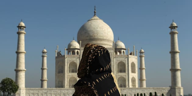 AGRA, INDIA - SEPTEMBER 29: A woman looks at the Taj Mahal on September 29, 2010 in Agra, India. Completed in 1643, the mausoleum was built by th Mughal emperor Shah Jahan in memory of his third wife, Mumtaz Mahal, who is buried there alongside Jahan.  (Photo by Cameron Spencer/Getty Images)