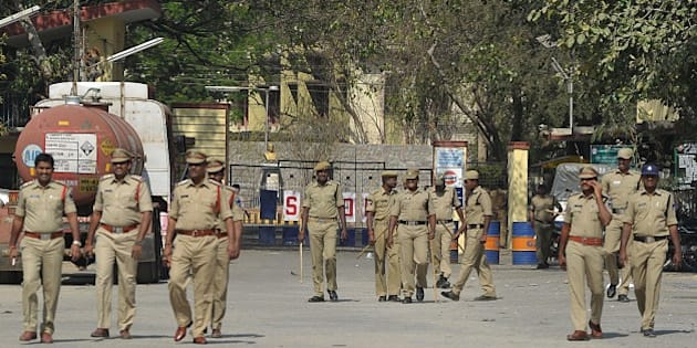 Indian police personnel patrol at the entrance to Gulf Oil Corporation Limited company (Explosives Division) in Hyderabad on February 24, 2015, following an explosion at the site. An explosion at lubricants maker Gulf Oil Corp's unit in southern India killed two people and injured at least 13 others late February 23, police said. Police said the explosion at Gulf Oil, which sells lubricants and industrial explosives in India and overseas, took place after detonators were being disposed of at its office located in the southern Indian city of Hyderabad in Andhra Pradesh state.   AFP PHOTO / Noah SEELAM        (Photo credit should read NOAH SEELAM/AFP/Getty Images)