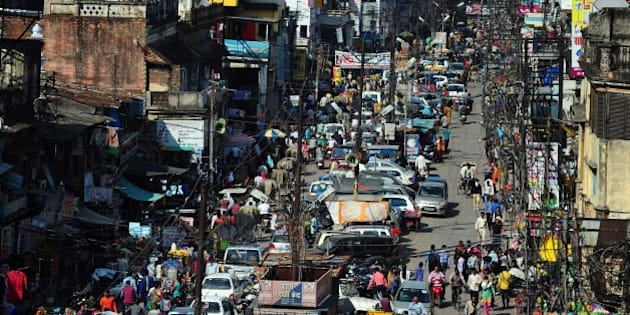 To go with story 'India-economy-urbanisation' by Trudy HARRIS In this photograph taken on March 4, 2015 Indian commuters travel along a busy road during a traffic jam as there is no parking and traffic control system in the middle of the old city in Allahabad.Its roads are clogged with traffic, the pavements overflow with rubbish and power cuts are a fact of life. But Allahabad, an ancient settlement on the banks of the Ganges, is hoping to become one of India's first tech-savvy 'smart cities' under ambitious plans being piloted by Prime Minister Narendra Modi.   AFP PHOTO / SANJAY KANOJIA        (Photo credit should read Sanjay Kanojia/AFP/Getty Images)