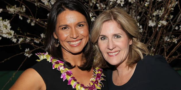 WASHINGTON, DC - MARCH 18: Rep. Tulsi Gabbard and Elizabeth Thorp attend the ELLE and HUGO BOSS Women in Washington Power List Dinner at The Residence of the German Ambassador on March 18, 2015 in Washington, DC.  (Photo by Paul Morigi/Getty Images for ELLE)