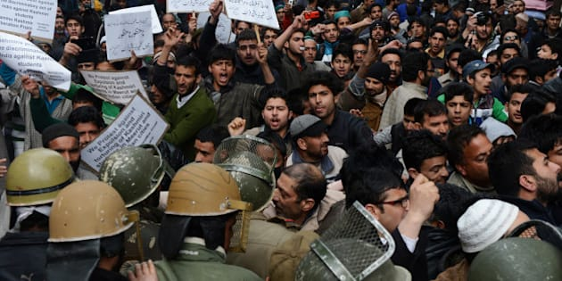 Supporters of the Jammu and Kashmir Libration Front (JKLF) shout anti-Indian slogans during a protest against the treatment of Kashmiri students from a university in Srinagar on March 7, 2014. Police in northern India said they had dropped sedition charges against a group of Kashmiri students who cheered on Pakistan in a recent cricket match, but they could still face prosecution over the incident. A group of 60 students were suspended from the Swami Vivekanand Subharti University (SVSU) in the town of Meerut and escorted from the campus over what the vice chancellor called 'unacceptable' behaviour after the match. AFP PHOTO/Tauseef MUSTAFA        (Photo credit should read TAUSEEF MUSTAFA/AFP/Getty Images)