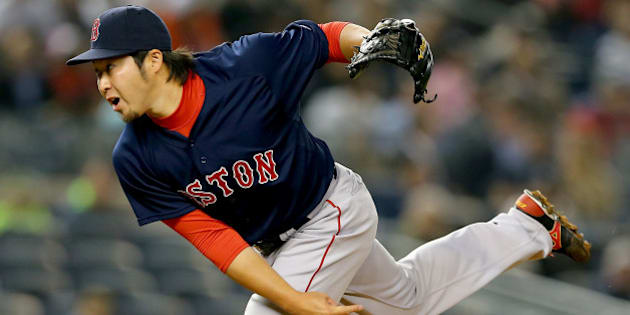 NEW YORK, NY - APRIL 10:  Junichi Tazawa #36 of the Boston Red Sox delivers a pitch in the 8th inning against the New York Yankees on April 10, 2015 at Yankee Stadium in the Bronx borough of New York City.  (Photo by Elsa/Getty Images)