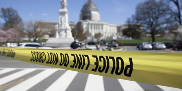 The north front of the U.S. Capitol is closed and a parameter created with police tape, Saturday, April 11, 2015, in Washington.   Police say the U.S. Capitol is on lockdown as a precaution after shots were fired in what appears to be an attempted suicide.  (AP Photo/Carolyn Kaster)