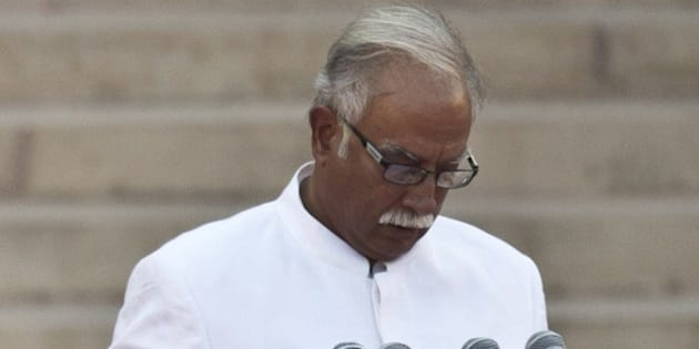 In this photograph taken on May 26, 2014, Telugu Desam Party (TDP) MP Ashok Gajapathi Raju takes the oath of office during a swearing-in ceremony for new Indian Prime Minister Narendra Modi and his council of ministers in New Delhi. India's Prime Minister Narendra Modi was expected to hold landmark talks with his Pakistani counterpart and announce his new cabinet May 27 as he looked to hit the ground running on his first day in office. AFP PHOTO/Prakash SINGH        (Photo credit should read PRAKASH SINGH/AFP/Getty Images)