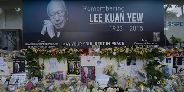 Pictures and flowers are seen in front of a memorial area for Singapore's late former prime minister Lee Kuan Yew outside the parliament building where he lies in state ahead of his funeral in Singapore on March 28, 2015. Singapore's first prime minister Lee Kuan Yew, one of the towering figures of post-colonial Asian politics, died at the age of 91 on March 23. AFP PHOTO / ADEK BERRY        (Photo credit should read ADEK BERRY/AFP/Getty Images)