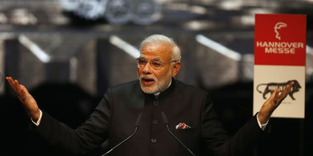 India's Prime Minister Narendra Modi speaks at the opening of the industrial fair in Hanover, Germany, Sunday, April 12, 2015. India is this years partner country and participates in one of the worlds biggest industrial fair that lasts till April 17, 2015. (AP Photo/Frank Augstein)