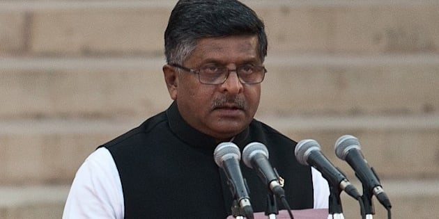 In this photograph taken on May 26, 2014, Bharatiya Janata Party (BJP) leader Ravi Shankar Prasad takes the oath of office during a swearing-in ceremony for new Indian Prime Minister Narendra Modi and his council of ministers in New Delhi. India's Prime Minister Narendra Modi was expected to hold landmark talks with his Pakistani counterpart and announce his new cabinet May 27 as he looked to hit the ground running on his first day in office. AFP PHOTO/Prakash SINGH        (Photo credit should read PRAKASH SINGH/AFP/Getty Images)