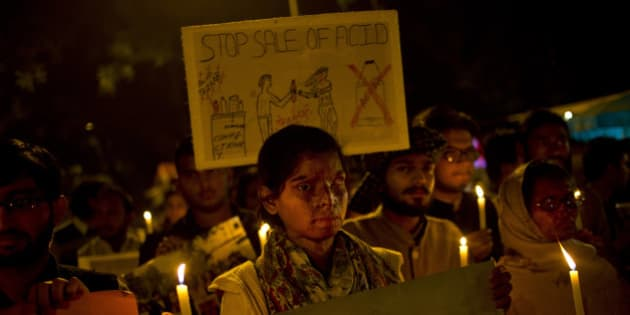 AP10ThingsToSee - Acid attack survivors participate in a candlelit vigil protesting violence against women as they mark the second anniversary of the deadly gang rape of a student on a bus, in New Delhi, India, Tuesday, Dec. 16, 2014. The case sparked public outrage and helped make women's safety a common topic of conversation in a country where rape is often viewed as a woman's personal shame to bear. (AP Photo/Saurabh Das)