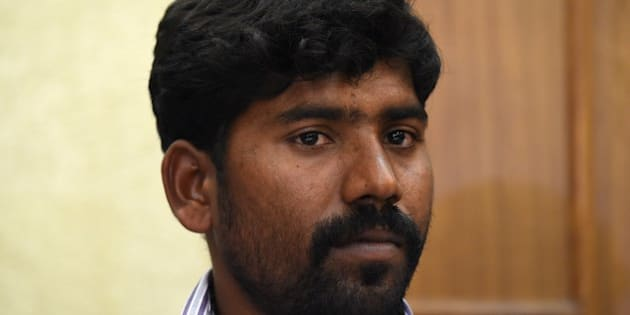 Indian witness-survivor Sekar, who was witness to the April 7, 2015 killings of 20 suspected illegal loggers by the Andhra Pradesh police, looks on during a press conference organised by the National Human Rights Commision in New Delhi on April 13, 2015.  Rights groups called April 8 for a full investigation into the death of 20 suspected illegal loggers, killed when police opened fire in a forest in southern India notorious for sandalwood smuggling. AFP PHOTO / SAJJAD HUSSAIN        (Photo credit should read SAJJAD HUSSAIN/AFP/Getty Images)