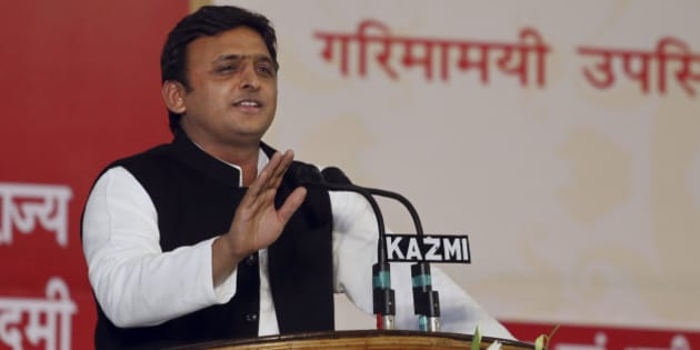 Uttar Pradesh state chief minister Akhilesh Yadav addresses a gathering in Lucknow, India, Tuesday, Feb. 25, 2014. Yadav inaugurated 17 projects and laid the foundation stone of 26 others. He also distributed loan waiver certificates to 7,017 farmers, according to local reports. (AP Photo/Rajesh Kumar Singh)