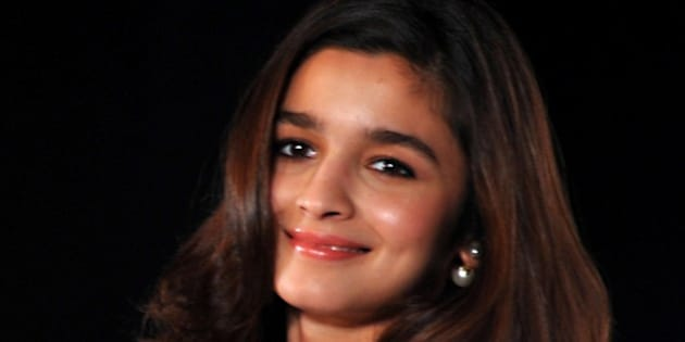 Indian Bollywood actress Alia Bhatt poses for a photograph during a promotional event in Mumbai on late August 11, 2014. AFP PHOTO/STR        (Photo credit should read STRDEL/AFP/Getty Images)