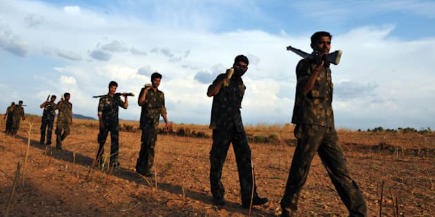 Indian Special Security Force personnel deployed for anti-Naxal operations perform a security sweep near the airport ahead of expected flight arrivals of high-profile guests at the Puttaparthi village, some 200 kms norh of Bangalore, on April 23, 2011. Indian spiritual leader Sai Baba, one of the country's most famous gurus, remained in a critical condition on April 22 as devotees prayed for a miracle to save his life. AFP PHOTO/ Dibyangshu SARKAR (Photo credit should read DIBYANGSHU SARKAR/AFP/Getty Images)
