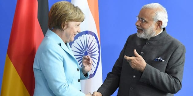 German Chancellor Angela Merkel and Indian Prime Minister Narendra Modi shake hands after a news conference on their talks in Berlin April 14, 2015. AFP PHOTO / TOBIAS SCHWARZ        (Photo credit should read TOBIAS SCHWARZ/AFP/Getty Images)