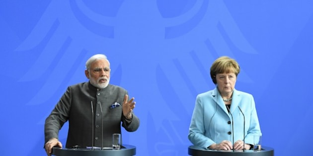 German Chancellor Angela Merkel and Indian Prime Minister Narendra Modi address a press conference on their talks in Berlin April 14, 2015. AFP PHOTO / TOBIAS SCHWARZ        (Photo credit should read TOBIAS SCHWARZ/AFP/Getty Images)