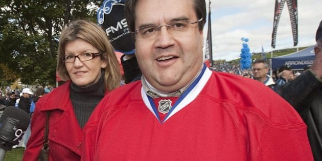 """MP Denis Coderre, right, dressed in a Montreal Canadiens jersey, arrives on the on the Plains of Abraham for """"La Marche Bleue"""", a gathering asking for a comeback of an NHL team and a new arena to the city, on Saturday, October 2, 2010 in Quebec City. Over 60,000 people attended. THE CANADIAN PRESS/Jacques Boissinot"""