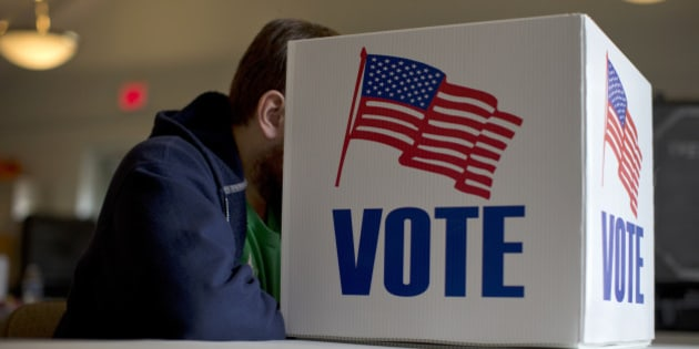 A voter fills our a provisional ballot by hand for the midterm elections at a polling place in Annapolis, Md., Tuesday, Nov. 4, 2014. (AP Photo/Carolyn Kaster)