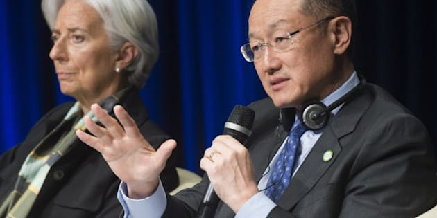 World Bank Group President Jim Yong Kim (R) speaks as  International Monetary Fund (IMF) Managing Director Christine Lagarde looks on during the 2015 Global Parliamentary Conference at World Bank Headquarters in Washington, DC on April 13, 2015. The International Monetary Fund updated its forecasts on growth in the global economy ahead of the IMF and World Bank spring meetings this week. AFP PHOTO/ SAUL LOEB        (Photo credit should read SAUL LOEB/AFP/Getty Images)