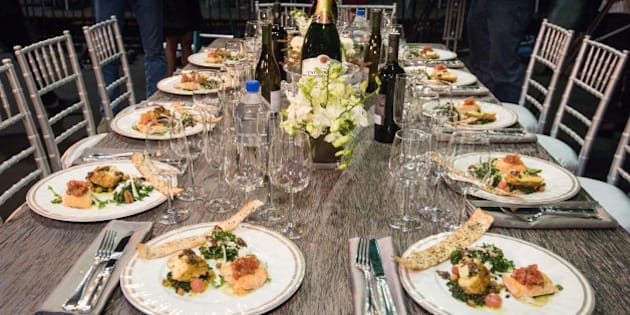 "Prepared dishes appear at a table during the SAG Awards ""behind the scenes day"" at the L.A. Shrine Exposition Center on Thursday Jan 22, 2015, in Los Angeles. The menu for attendees at the awards show on Sunday includes Moroccan spiced chicken with lentils and chickpeas and grilled salmon with truffle tomato vinaigrette, arugula and shaved fennel. (Photo by Rob Latour/Invision/AP)"
