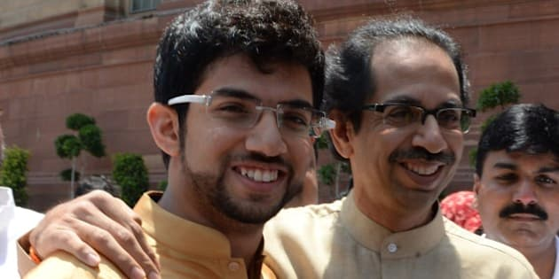 Shiv Sena leader Udhav Thakre (R) and his son Aditya arrive at Parliament house in New Delhi on May 20, 2014. Narendra Modi told reporters after meeting President Pranab Mukherjee that his swearing-in would take place on May 26.  AFP PHOTO/Prakash SINGH        (Photo credit should read PRAKASH SINGH/AFP/Getty Images)