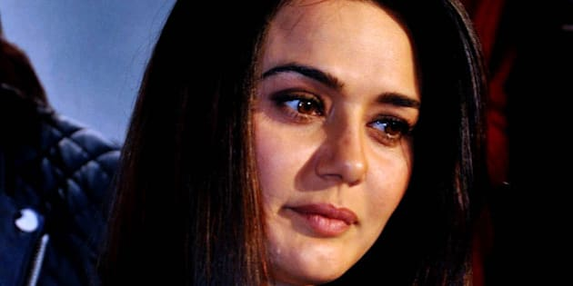 Indian Bollywood film actress Preity Zinta poses during the press meet for the Hindi film 'Ishkq in Paris' directed by Prem Raj in Mumbai on April 30,2013.   AFP PHOTO        (Photo credit should read STR/AFP/Getty Images)
