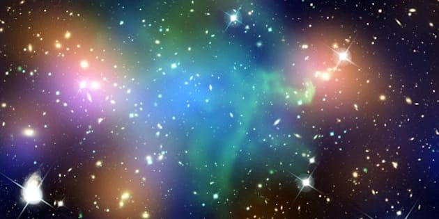 """This composite image shows the distribution of dark matter, galaxies, and hot gas in the core of the merging galaxy cluster Abell 520, formed from a violent collision of massive galaxy clusters that is located about 2.4 billion light years from Earth.   Data from NASA's Chandra X-ray Observatory show the hot gas in the colliding clusters colored in green. The gas provides evidence that a collision took place. Optical data from NASA's Hubble Space Telescope and the Canada-France-Hawaii Telescope (CFHT) in Hawaii are shown in red, green, and blue. Starlight from galaxies within the clusters, derived from observations by the CFHT and smoothed to show the location of most of the galaxies, is colored orange.   The blue-colored areas pinpoint the location of most of the mass in the cluster, which is dominated by dark matter. Dark matter is an invisible substance that makes up most of the universe's mass. The dark-matter map was derived from the Hubble observations, by detecting how light from distant objects is distorted by the cluster galaxies, an effect called gravitational lensing. The blend of blue and green in the center of the image reveals that a clump of dark matter (which can be seen by mousing over the image) resides near most of the hot gas, where very few galaxies are found.   This finding confirms previous observations of a dark-matter core in the cluster announced in 2007. The result could present a challenge to basic theories of dark matter, which predict that galaxies should be anchored to dark matter, even during the shock of a powerful collision.   Credit: NASA, ESA, CFHT, CXO, M.J. Jee (University of California, Davis), and A. Mahdavi (San Francisco State University)   Read entire caption/view more images: <a href=""""http://www.chandra.harvard.edu/photo/2012/a520/"""" rel=""""nofollow"""">www.chandra.harvard.edu/photo/2012/a520/</a>  Caption credit: Harvard-Smithsonian Center for Astrophysics  Read more about Chandra: <a href=""""http://www.nasa.gov/chandra"""" rel=""""nof"""