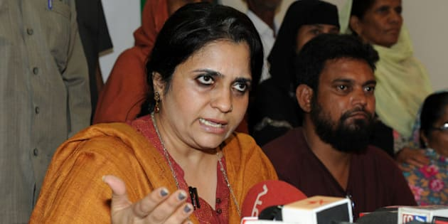 Teesta Setalvad (C), Secretary of Citizens for Justice and Peace, speaks to the media during a press conference in Ahmedabad on March 22, 2010. Teesta said that Gujarat state Chief Minister Narendra Modi should appear before the Special Investigation Team constituted by the Supreme Court of India. Congress Member of Parliament (MP) Ehsan Jafri was amongst a total of 59 Muslims hacked to death on February 28, 2002 by a rioting mob in Ahmedabad's Gulberg Society. Zakia Ehsan Jafri widow of slained Congress MP Ehsan Jafri filed a case against 62 people including Gujarat state Chief Minister Narendra Modi in the Indian Supreme Court which prompted the Special Investigation Team (SIT) to summon Narendra Modi. AFP PHOTO/ Sam PANTHAKY (Photo credit should read SAM PANTHAKY/AFP/Getty Images)