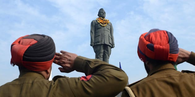 Indian Punjab police salute the statue of  freedom fighter, Netaji Subhash Chandra Bose in Amritsar on January 23, 2013, as part of celebrations for his 116th birth anniversary. Bose was a prominent Indian nationalist leader who attempted to gain India's independence from British rule by force during the waning years of World War II.  AFP PHOTO/NARINDER NANU        (Photo credit should read NARINDER NANU/AFP/Getty Images)
