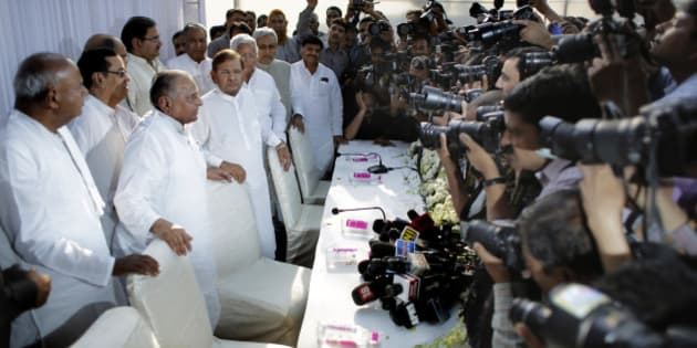 """Indian photographers take pictures of Janata Dal (Secular) party leader H.D. Deve Gowda, left, Samajwadi Party chief Mulayam Singh Yadav, second left, Janata Dal (United), a powerful group in eastern Bihar state, chief Sharad Yadav, center, Bihar state chief minister Nitish Kumar, second right, and former Indian Railway Minister and leader of Rashtriya Janata Dal Lalu Prasad Yadav, during a press conference in New Delhi, India, Wednesday, April 15, 2015. Six parties that were once part of """"Janata Parivar"""", a term used in Indian politics to describe the various political parties that emerged from Janata Dal party, announced on Wednesday that they will merge to form a national party under the leadership of Mulayam Singh Yadav. (AP Photo/Altaf Qadri)"""