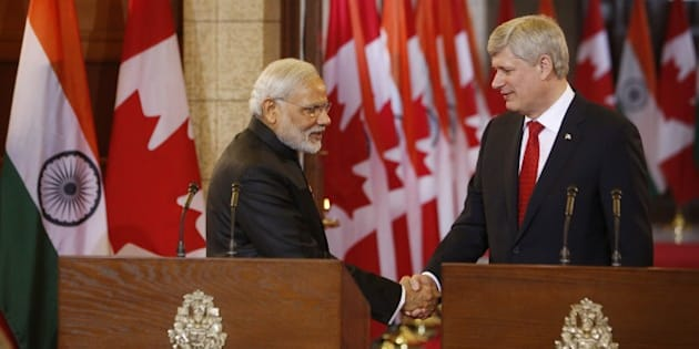 Canada's Prime Minister Stephen Harper shakes hands with India's Prime Minister Narendra Modi (L) during a joint press conference on Parliament Hill  in Ottawa, Canada on April 15, 2015. Prime Minister Modi will continue his official visit to Canada in Toronto and Vancouver. AFP PHOTO/ COLE BURSTON        (Photo credit should read Cole Burston/AFP/Getty Images)