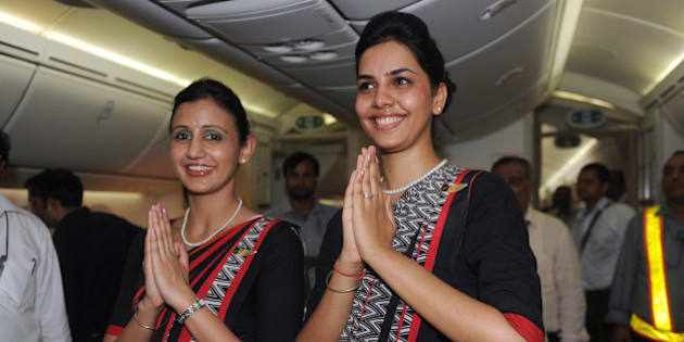 Air India flight attendants pose for a photo during the unveiling of Air India's first Boeing 787 Dreamliner at Indira Gandhi International airport terminal 3 in New Delhi, on September 12, 2012. The factory fresh 256-seater Boeing 787 Dreamliner is the first of 27 Dreamliners Air India has purchased for their fleet. AFP PHOTO/ RAVEENDRAN        (Photo credit should read RAVEENDRAN/AFP/GettyImages)