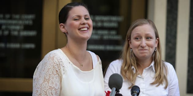 ARLINGTON, VA - OCTOBER 06:  Erika Turner (R) and Jennifer Melsop (L) of Centreville, Virginia, rejoice as they becomes the first same sex marriage couple in Arlington County as they speak to members of the media outside Arlington County Courthouse October 6, 2014 in Arlington, Virginia. The U.S. Supreme Court announced that it will not hear the five pending same-sex marriage cases, paving the way for gay and lesbian marriage in 11 more states.  (Photo by Alex Wong/Getty Images)