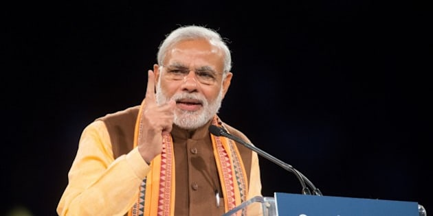 Indian Prime Minister Narendra Modi addresses a crowd of nearly 10,000 during a rally at Ricoh Coliseum in Toronto on Prime Minister Modi's first official visit to Canada, April 15, 2015.   Nearly 1.2 million Canadians trace their roots to India. South Asians are the largest visible minority in Canada.    AFP PHOTO / GEOFF ROBINS        (Photo credit should read GEOFF ROBINS/AFP/Getty Images)