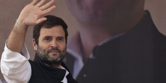 India's opposition Congress party Vice President Rahul Gandhi waves to the crowd during an election campaign rally ahead of Delhi state election in New Delhi, India, Wednesday, Feb. 4, 2015. Delhi goes to the polls on Feb. 7. (AP Photo/Tsering Topgyal)