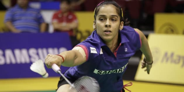 India's Saina Nehwal returns a shot to China's Sun Yu during their women's singles quarterfinal match at the Malaysia Open badminton tournament in Kuala Lumpur, Malaysia, Friday, April 3, 2015. (AP Photo/Vincent Thian)