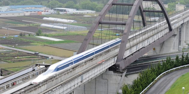 The Maglev (magnetic levitation) train carrying US Transport Secretary Ray LaHood speeds during a test run on the experimental track in Tsuru, 100km west of Tokyo, on May 11, 2010.  The US transport chief took a test ride on Japan's super-fast magnetic train, a contender for President Barack Obama's multi-billion-dollar national railway project. Japan is up against China, France, Germany and other bidders as it seeks to sell its 'Shinkansen' bullet and magnetic trains for the 13-billion-USD US high-speed national rail grid.    AFP PHOTO/Toru YAMANAKA (Photo credit should read TORU YAMANAKA/AFP/Getty Images)