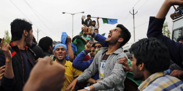 Supporters of senior separatist leader of Hardliner Faction of All Parties Hurriyat Conference Syed Ali Shah Geelani shout slogans during a rally in Srinagar, India, Wednesday, April 15, 2015. Geelani, who returned from New Delhi after over two months, was given a rousing welcome by his supporters and leaders of Hurriyat during the rally. (AP Photo/Mukhtar Khan)