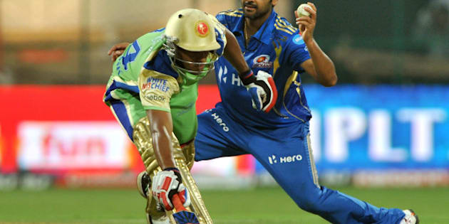 Royal Challengers Bangalore batsman Mayank Agarwal (L) makes it to the crease while Mumbai Indians bowler R.P. Singh attempts a run out during the IPL Twenty20 cricket match between Royal Challengers Bangalore and Mumbai Indians at the M. Chinnaswamy Stadium in Bangalore on May 14, 2012.   RESTRICTED TO EDITORIAL USE. MOBILE USE WITHIN NEWS PACKAGE.  AFP PHOTO/Manjunath KIRAN        (Photo credit should read Manjunath Kiran/AFP/GettyImages)