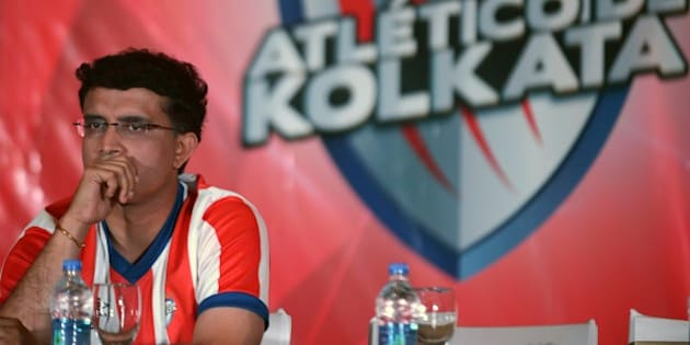 Sourav Ganguly, former Indian cricket captain and co-owner of the Atletico De Kolkata, looks on during the launch of the football team for the Indian Super League (ISL) in Kolkata on September 28, 2014. Ganguly, with three other city based corporate honchos, has Spanish League leaders Atletico Madrid as one of the key partners for the Kolkata franchise of the inaugural edition of the Indian Super League (ISL). AFP PHOTO/Dibyangshu SARKAR        (Photo credit should read DIBYANGSHU SARKAR/AFP/Getty Images)