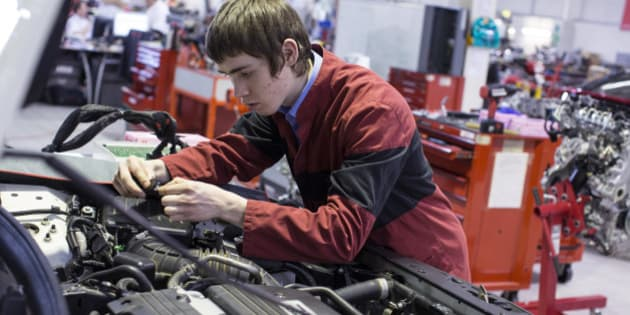 SLOUGH, ENGLAND - FEBRUARY 18:  Young adults perform practical tasks in the 'Honda Institute' as part of their Honda Apprenticeship Programme to become qualified Car Service Technicians on February 18, 2014 in Slough, England. The 2 or 3 year progammes include one week's residential training every 10 weeks in the course of becoming proficient in servicing machines as diverse as: cars, motorcycles, all terrain vehicles, marine engines and garden equipment.  (Photo by Oli Scarff/Getty Images)