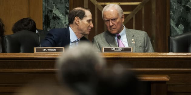 WASHINGTON, DC - APRIL 16:   Ranking Member Ron Wyden (D-OR), left, and Chairman Orrin Hatch (R-UT), right, speak during the Senate Finance Committee hearing on Congress and U.S. Tariff Policy in the Senate Dirksen Office building on April 16, 2015 in Washington, D.C. Congressional leaders in the tax writing committees reached a deal that would allow President Obama 'fast track' authority on negotiations on the Trans-Pacific Trade Agreement. (Photo by Gabriella Demczuk/Getty Images)